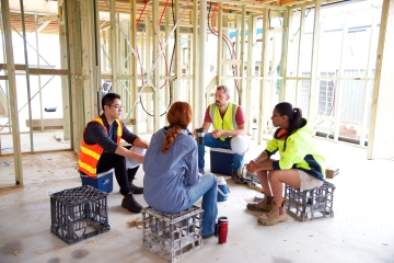 iStock-890101686%20-%20Diverse%20construction%20workers%20meeting%20sitting%20down%20-%20360%20x%20240.jpg