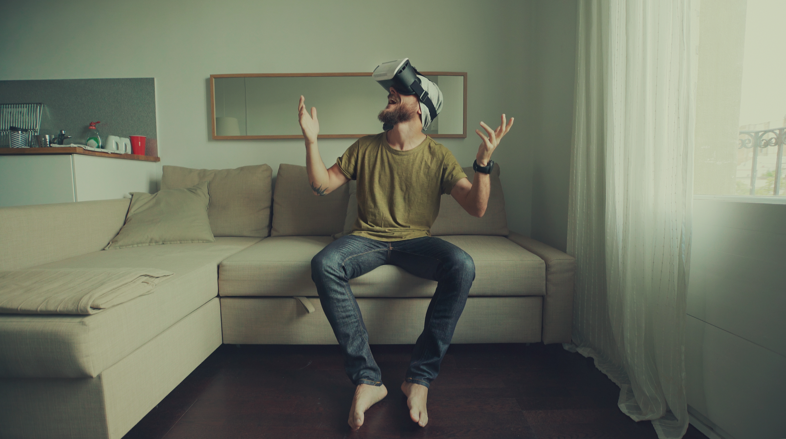 iStock-612843836%20-%20Man%20wearing%20virtual%20reality%20headset%20at%20home.jpg